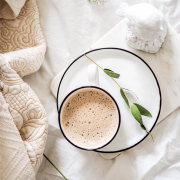 coffee cup on bed with plants